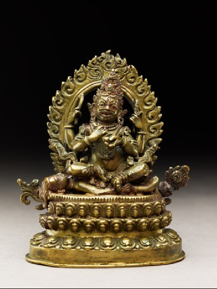 Figure of Mahakala seated on a corpse upon a lotus-petalled thronefront