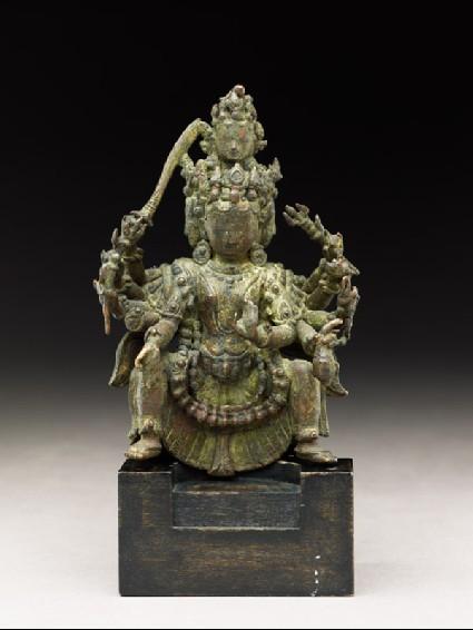 Figure of a multi-headed and multi-armed deityside