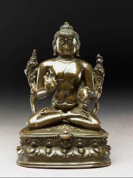 Seated figure of the Buddha with flowers, stupa, and bottlefront