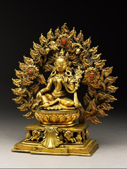 Seated figure of a female deity, possibly Tara, with a mandorla of flamesside