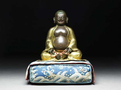 Figure of Hvashang seated on a cushionfront