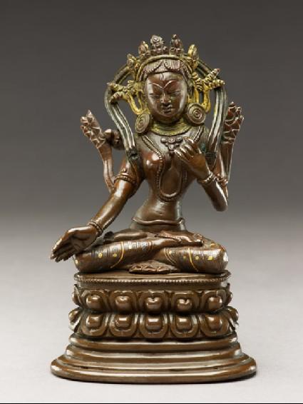 Seated figure of a female deityfront