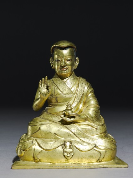 Seated figure of Tashi Lamafront