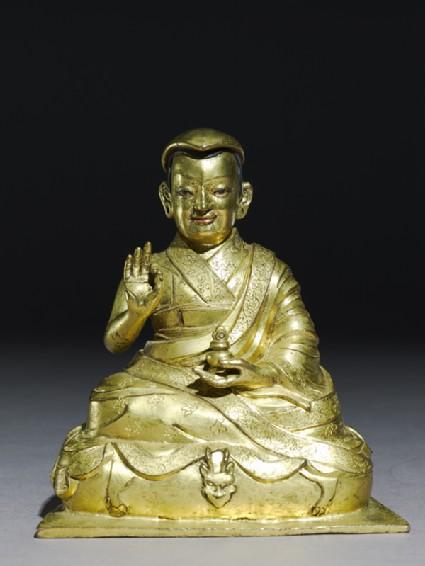 Seated figure of Tashi Lamafront