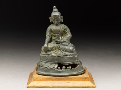 Seated figure of a deity on a lotus-petalled thronefront