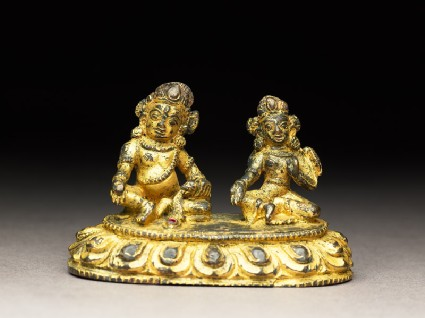 Figure of a male deity and his consort on a lotus-petalled throneside