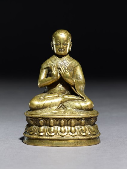 Figure of a seated lamaside
