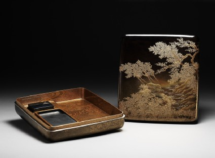 Suzuribako, or writing box, with cherry trees on a river bankoblique, open