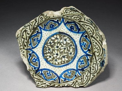 Base fragment of a bowl with flowerstop