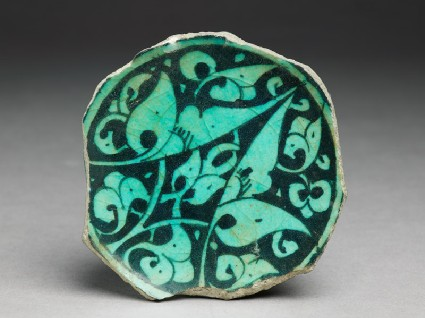 Base fragment of a bowl with floral decorationtop