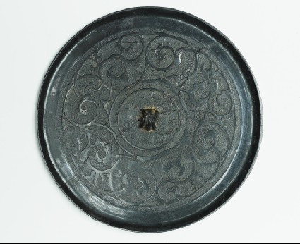 Ritual mirror with scrolling interlace decorationfront