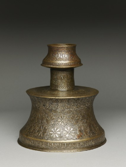 Candlestick with rosettes inscribed with good wishesoblique