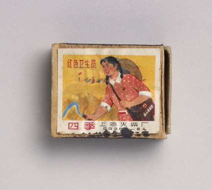 Matchbox depicting a woman holding a sickletop
