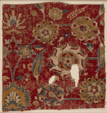Mughal carpet fragment with scrolling vines and blossomsfront