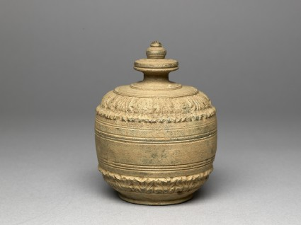 Lidded reliquary containing votive offeringsoblique