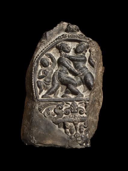 Pillar fragment with two wrestlersfront