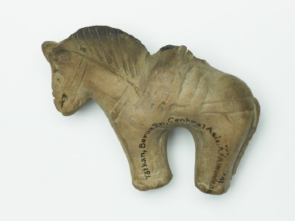 Terracotta figure of a horse and riderfront