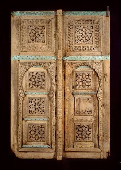 Wooden doors with floral decorationfront