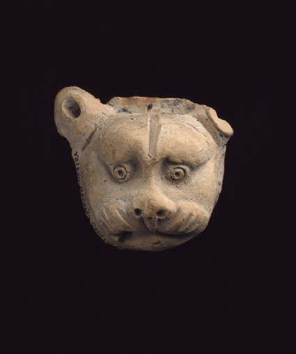 Lion mask from a vasefront