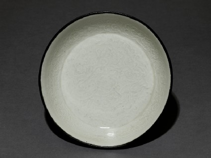 White ware bowl with dragons, flowers, and cloudstop