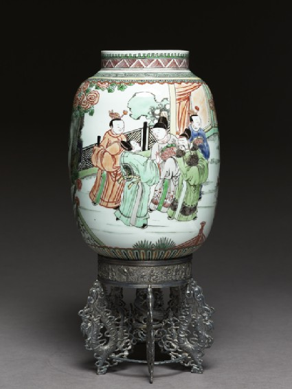 Lantern with figures in a gardenside