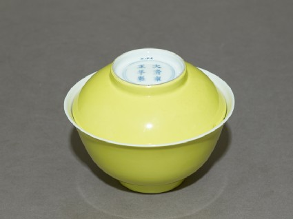 Bowl and lid with yellow glazeoblique