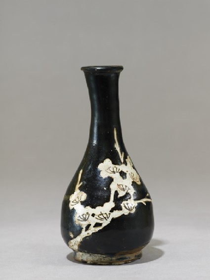 Black ware vase with prunus sprayside