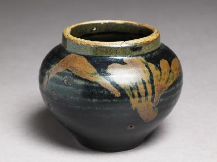Black ware jar with leaf designoblique