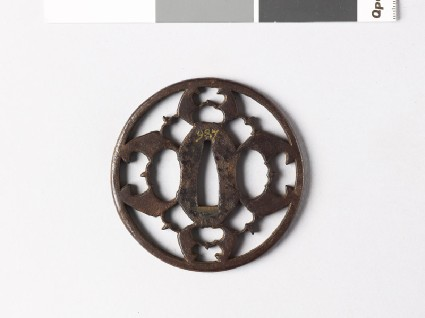 Round tsuba with myōga, or ginger shoots, and karigane, or flying geesefront