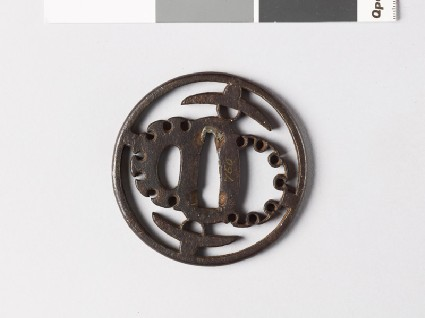 Round tsuba with hats and stylized snow heapsfront