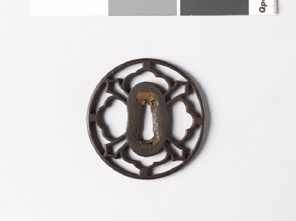 Tsuba with petals and sword-bladesfront