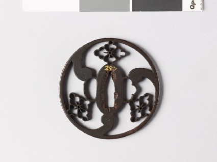 Round tsuba with karahana, or Chinese flowersfront