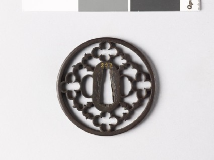 Round tsuba with karigane, or flying geesefront
