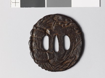 Tsuba with plants and a Buddhist invocationfront