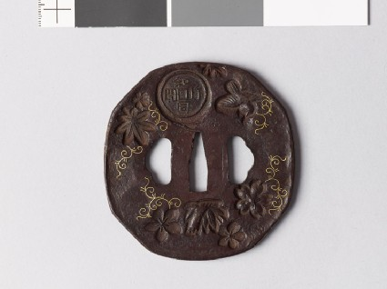 Octagonal tsuba with nine different stampsfront