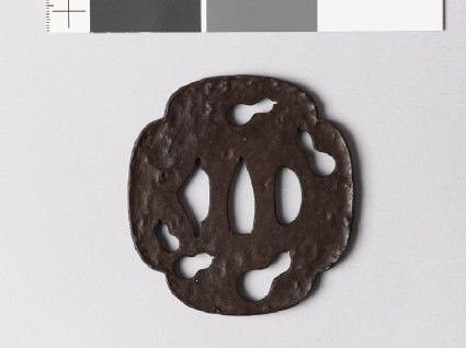 Mokkō-shaped tsuba with five gourds in negative silhouettefront