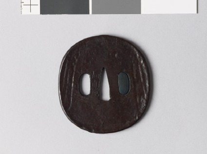 Lenticular tsuba with mitsudomoye, or three-comma shapesfront
