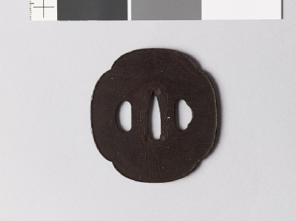 Mokkō-shaped tsuba with raised edgefront
