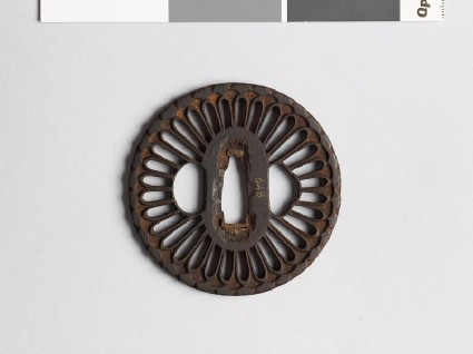 Round tsuba with chrysanthemum floretsfront
