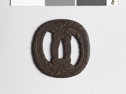 Tsuba with wisteria and dewdropsfront