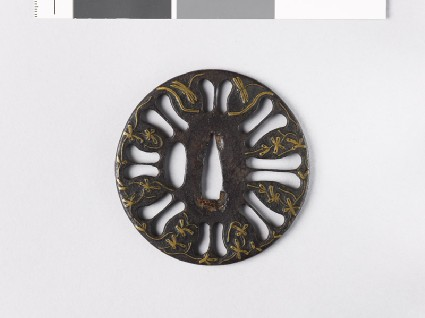 Tsuba with scrolls, dragonflies, and a streamfront