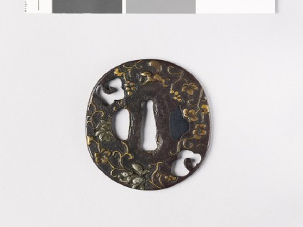 Tsuba with squirrels and a vinefront