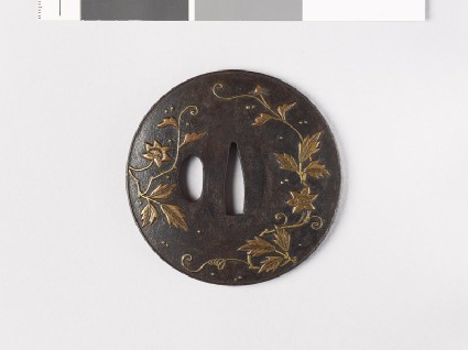 Lenticular tsuba with flowers and dewdropsfront