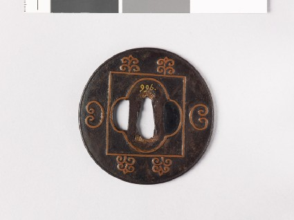 Lenticular tsuba with mokkō shape and C-scrollsfront