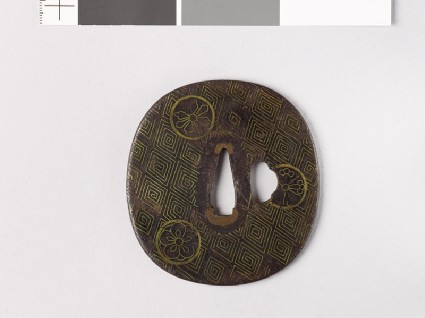Tsuba with thunder-scroll pattern and flowersfront