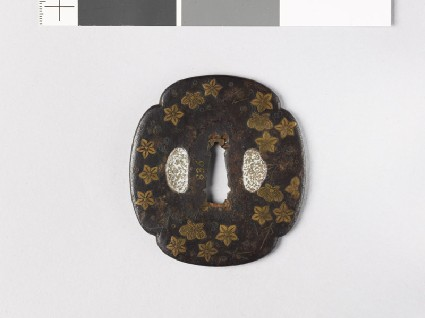 Mokkō-shaped tsuba with flowers and leavesfront