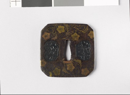 Square tsuba with karakusa, or scrolling floral patternfront