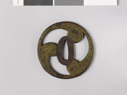 Tsuba in the form of a mitsudomoye, or three-comma shapefront