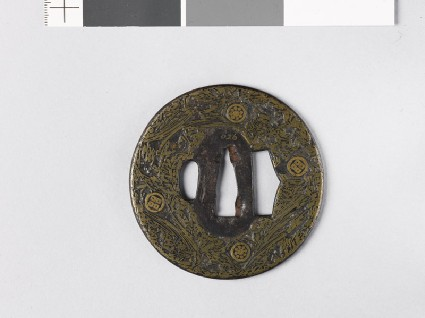 Round tsuba incrusted with brass wirefront