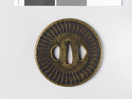 Tsuba with basketwork decorationfront